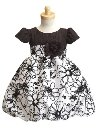 Наряженное платье белоснежного цвета с шоколадным лифом.Модель с...